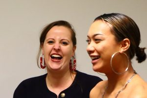 Close up of two women laughing