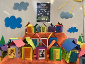 Collection of colourful houses made of paper
